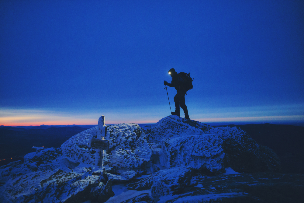 Teton tops off the first summit of the day, Mt. Madison (5,367ft.) at 6:24 AM after 3 1/2 hours of vertical night hiking. Photo Credit: Chris Bennett
