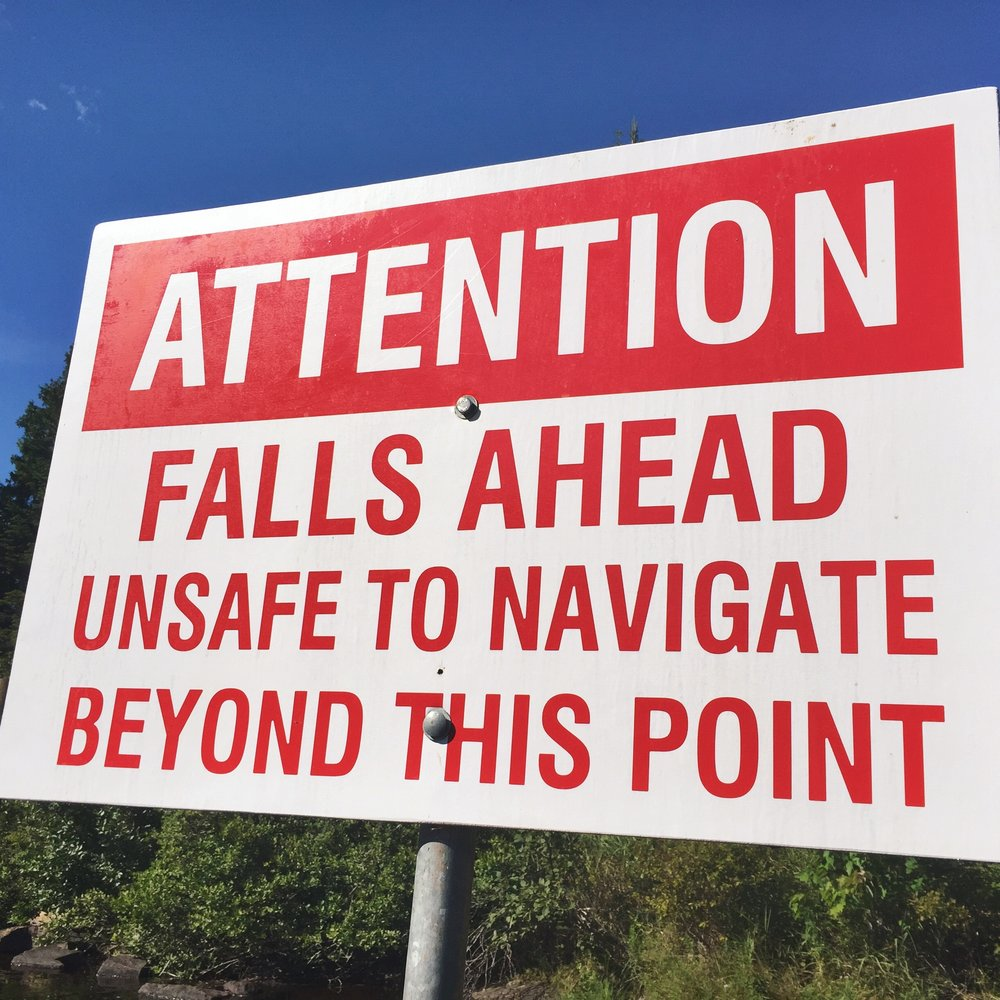 The warning sign for Buttermilk Falls.