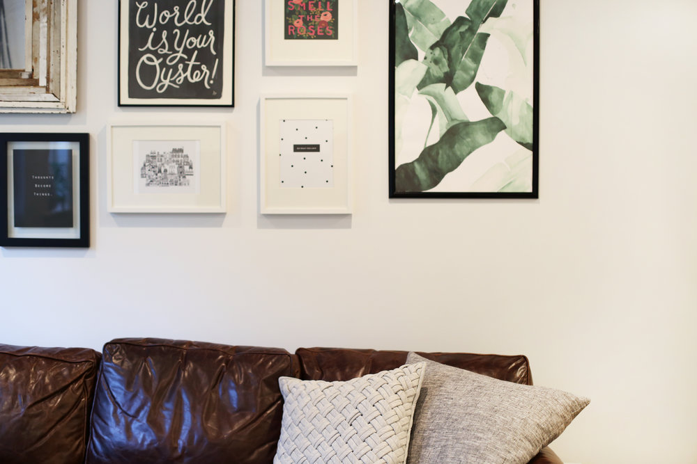 Gorgeous gallery wall and minimalist pillows.