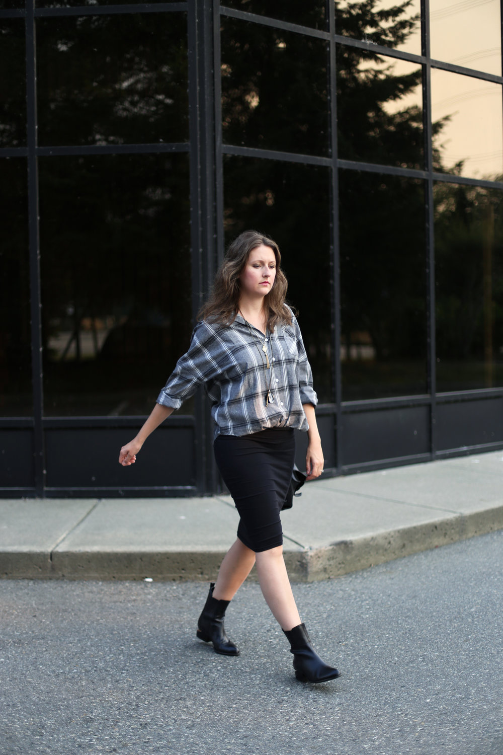 How to style an oversized plaid shirt with a skirt.