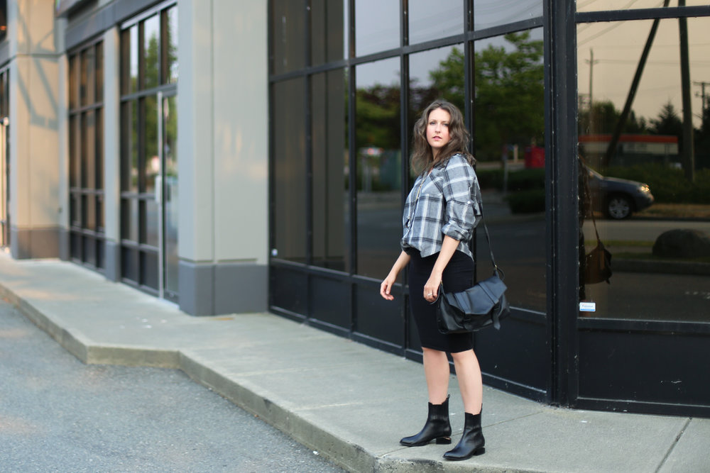 Minimalist outfit style: black leather messenger bag, alexander wang ankle boots, oversized plaid boyfriend shirt, and a skirt. #ootd #wiw