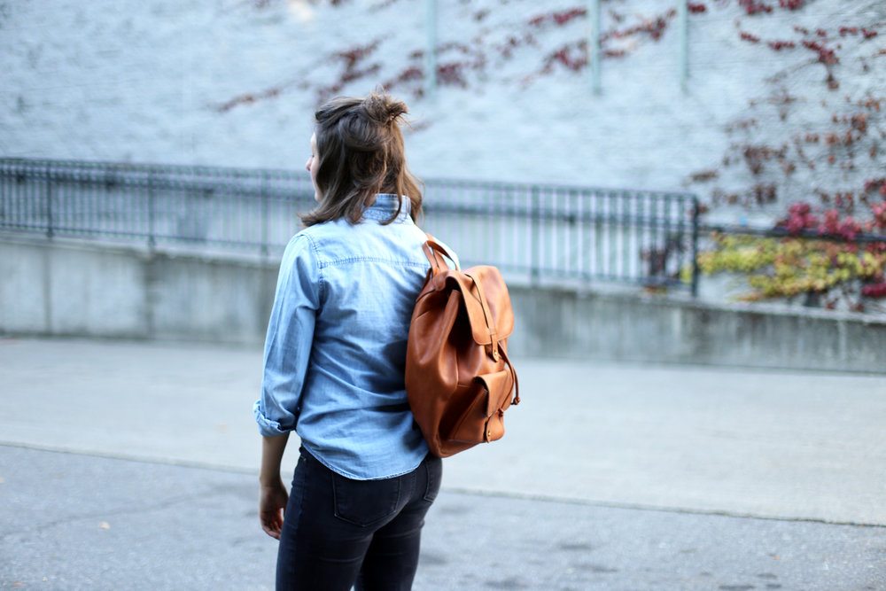 Cute and stylish leather backpack and a half up bun.
