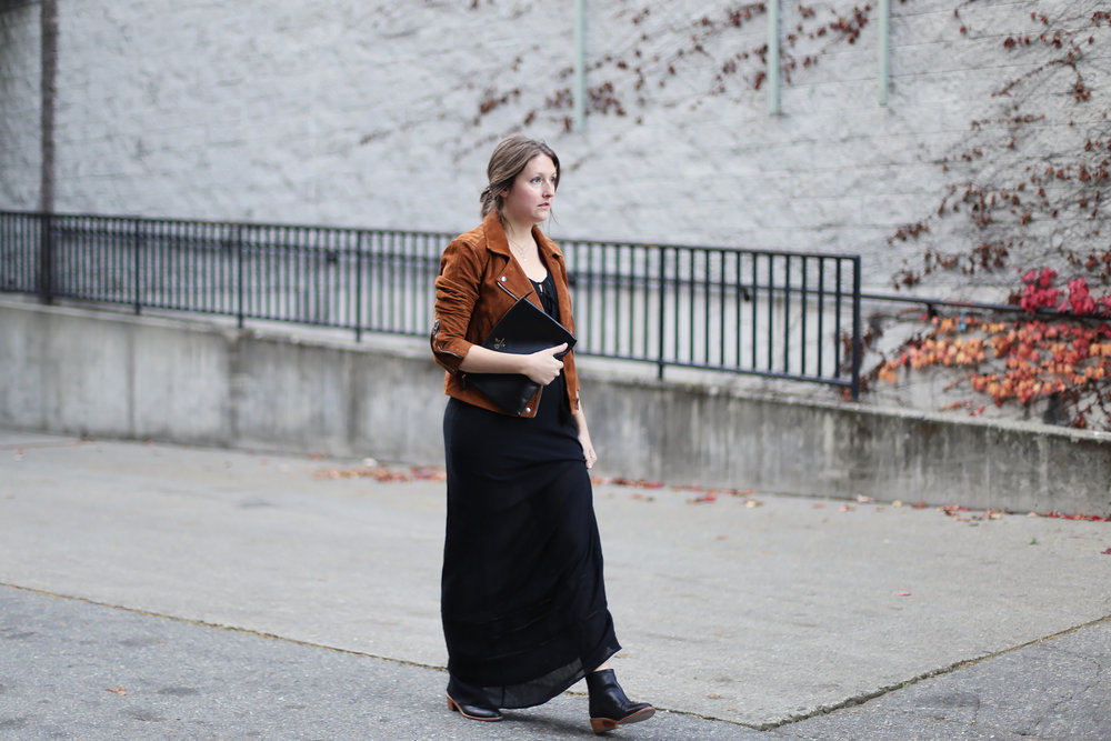Minimalist street style: black maxi dress, brown suede moto jacket, black booties, and a black clutch. #ootd