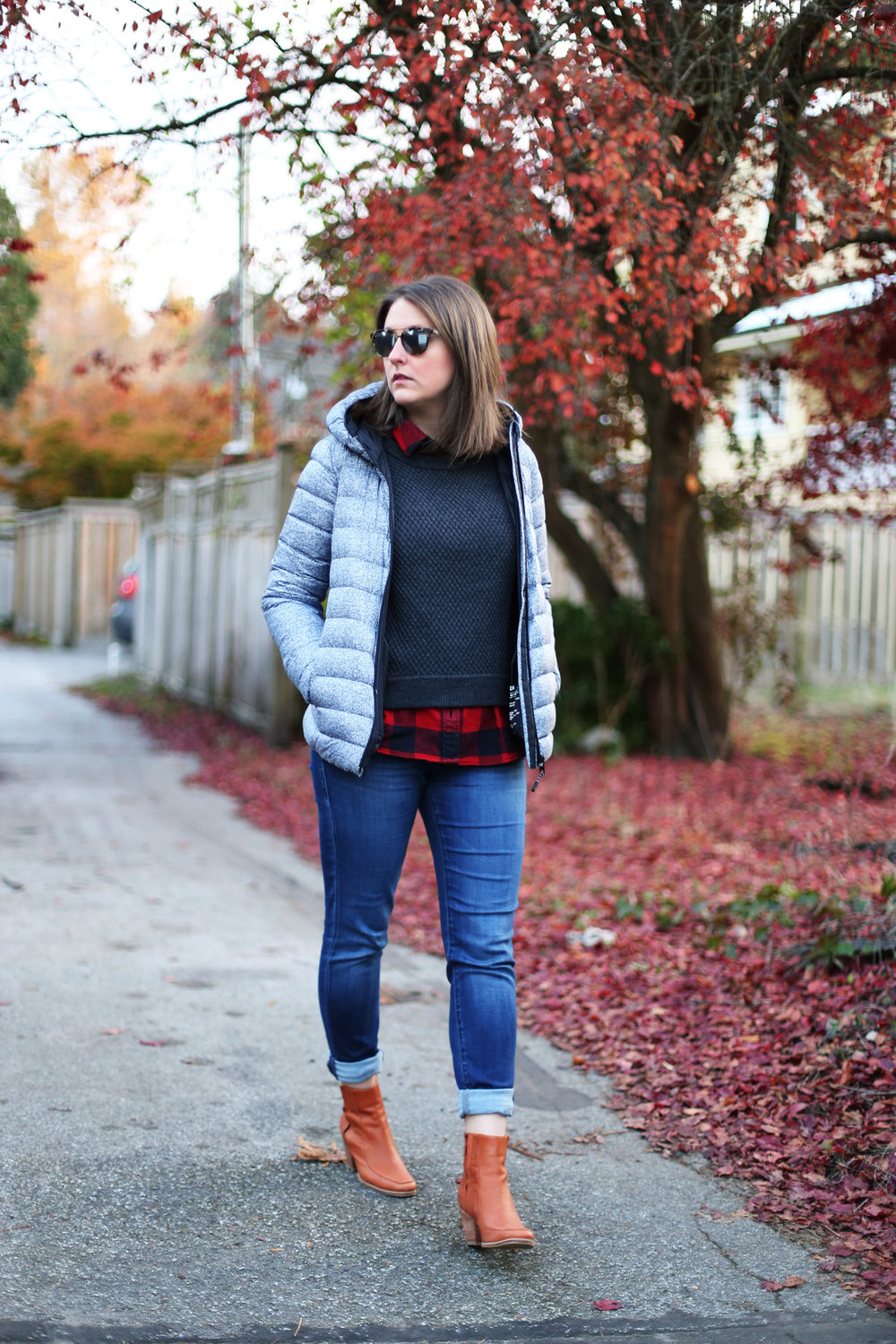 This puffer coat is stylish and warm! Love how she styles it with booties and skinny jeans. #ootd