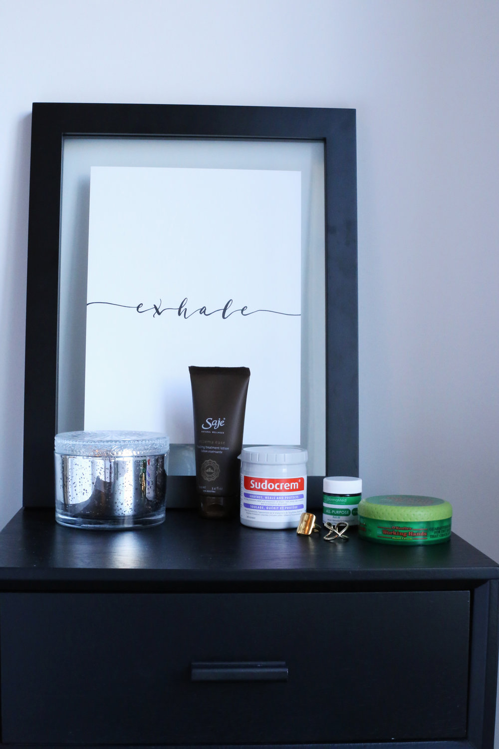 The products I use to manage the eczema on my ahnds: Saje Eczema Ease, Working Hands, Sudocrem, and DermaMed All Purpose Balm.