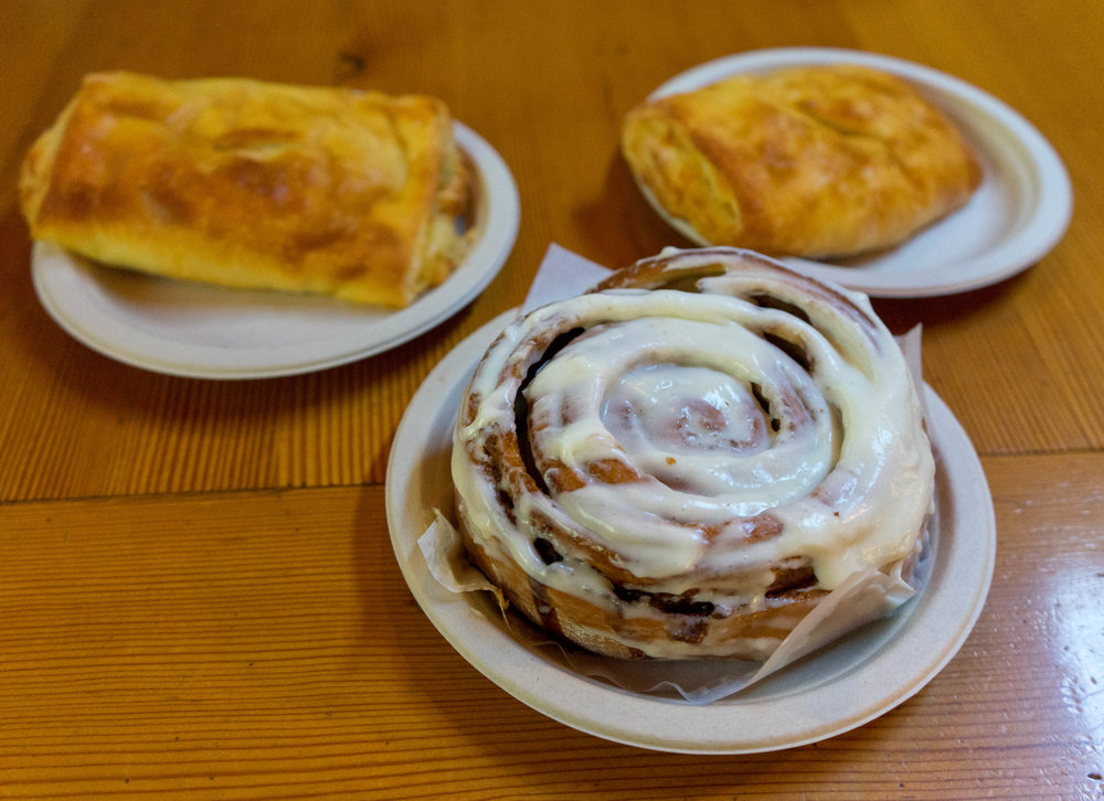 One famous cinnamon roll and two savory pocket pastries!