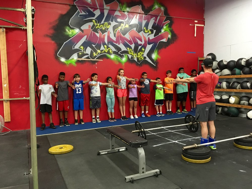 Hamden Kids getting a proper education on Bench Press mechanics from Coach Bobby
