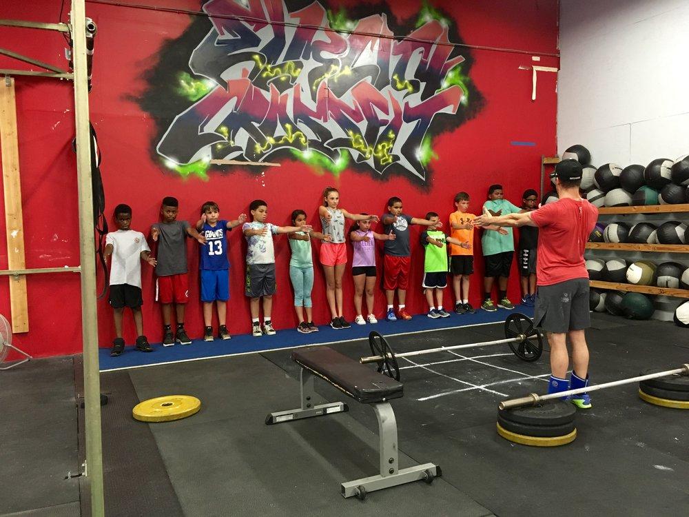 Hamden Kids getting a proper education on Bench Press mechanics from Coach Bobby