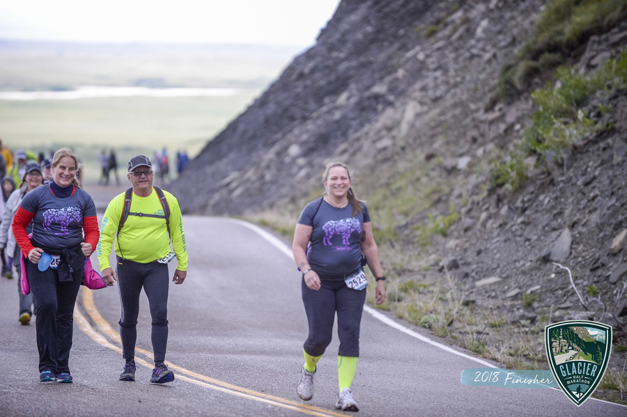"""Bonnie, Woody, and Shirley are all smiles as they get through the 5 mile uphill during the Glacier Half Marathon! Get ready to """"go the distance"""" with the Triple Three!"""