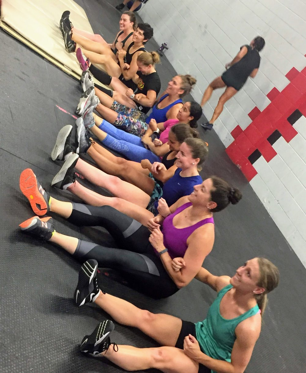 Not sure which is more awesome: arm-in-arm team sit-ups... or the fact that Monday's 5:30 class was full of bad-ass women.