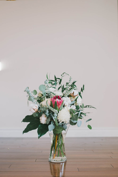 Flower Arrangement will be a Custom piece created for you with Fresh Seasonal Flowers! Just to Check out this amazing arrangement from Bethany Ann Flowers & Styling Portfolio