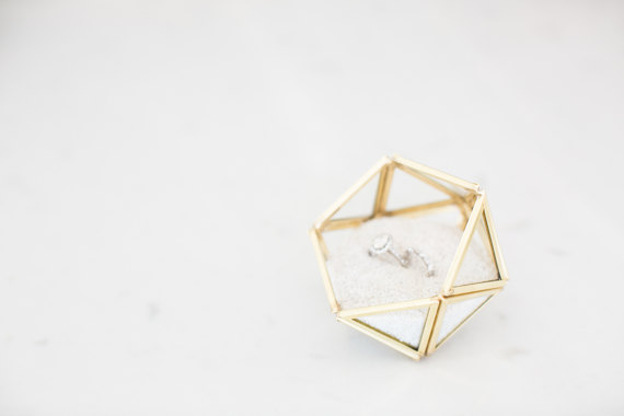 15 tiny tiny triangles individually wrapped in gold finish and assembled together to form this beautifully cute ring box -- via Etsy