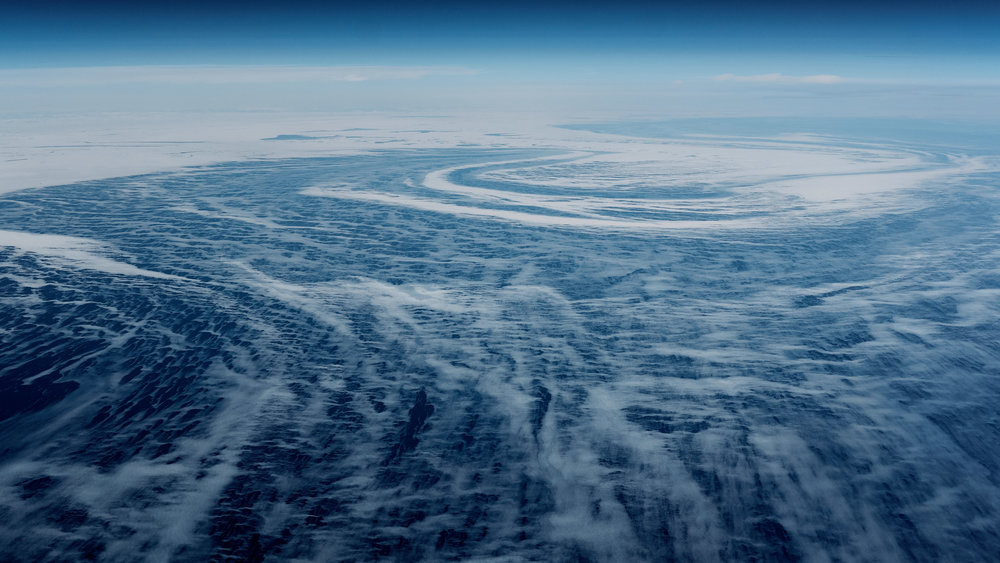 Ocean currents creating a huge vortex, near the coast of Goose Bay, Newfoundland and Labrador.