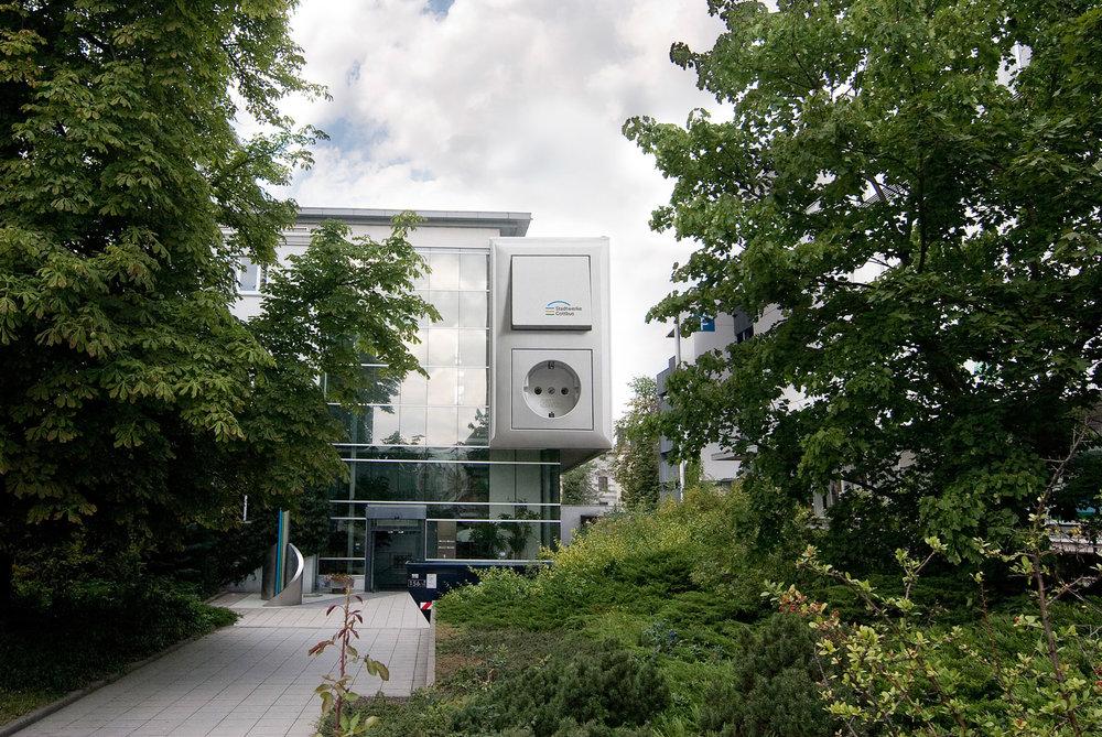 Fassadengestaltung-Industrie-Stadtwerke-Cottbus-Illusion-3D-Art-Werbung.jpg
