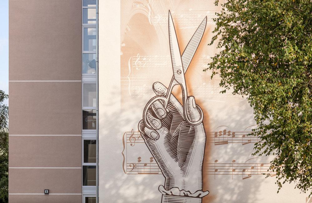 Fassaden-Gestaltung-Wohnungsbau-Mozart-Hand-Farbe.jpg