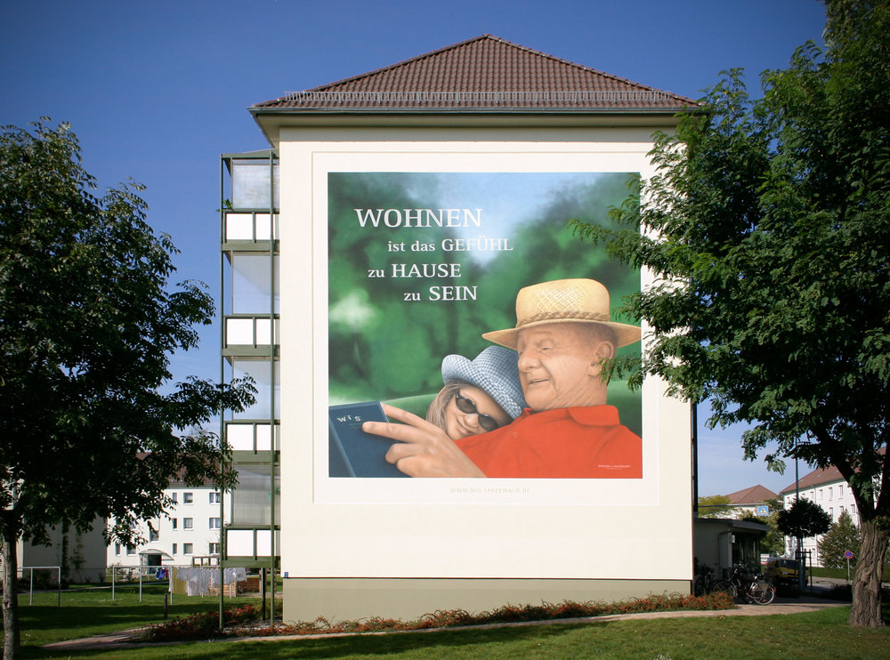 Fassaden-Gestaltung-Wohnungsbau-Mietwohnungen-Wandbilder-Luebbenau.jpg