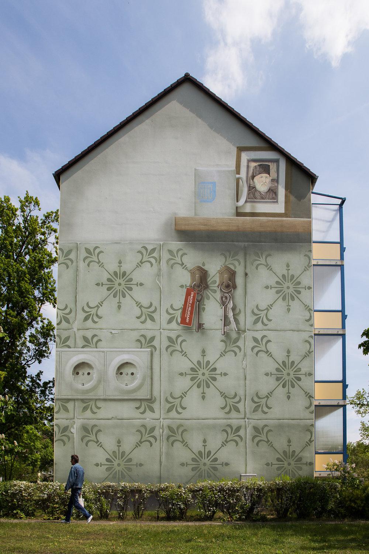 Fassaden-Gestaltung-Wohnungsbau-Pueckler-Giebelbild-Wandbild-Putz.jpg