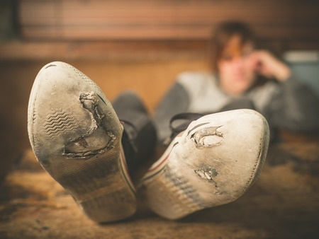 37355654_S_woman_soles_worn_resting_old_shoes.jpg