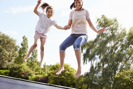 42310025_S_adult_mother_daughter_girl_woman_trampoline_jumping_feet_ankles.jpg