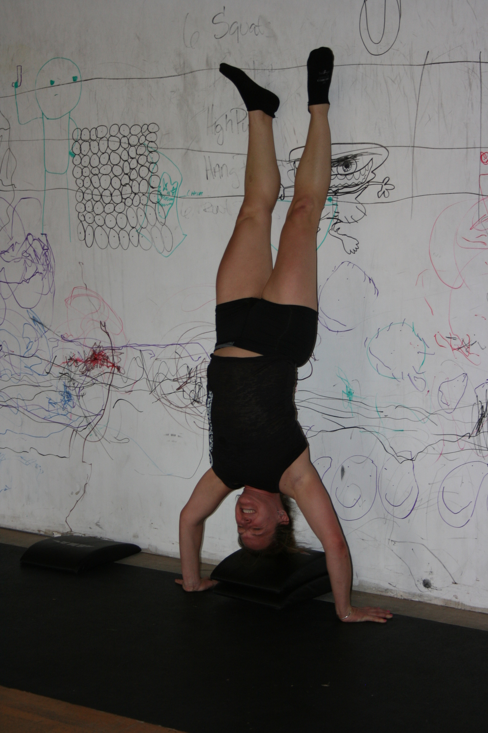 Angela doing handstand push-ups back on April 29th, 2012.