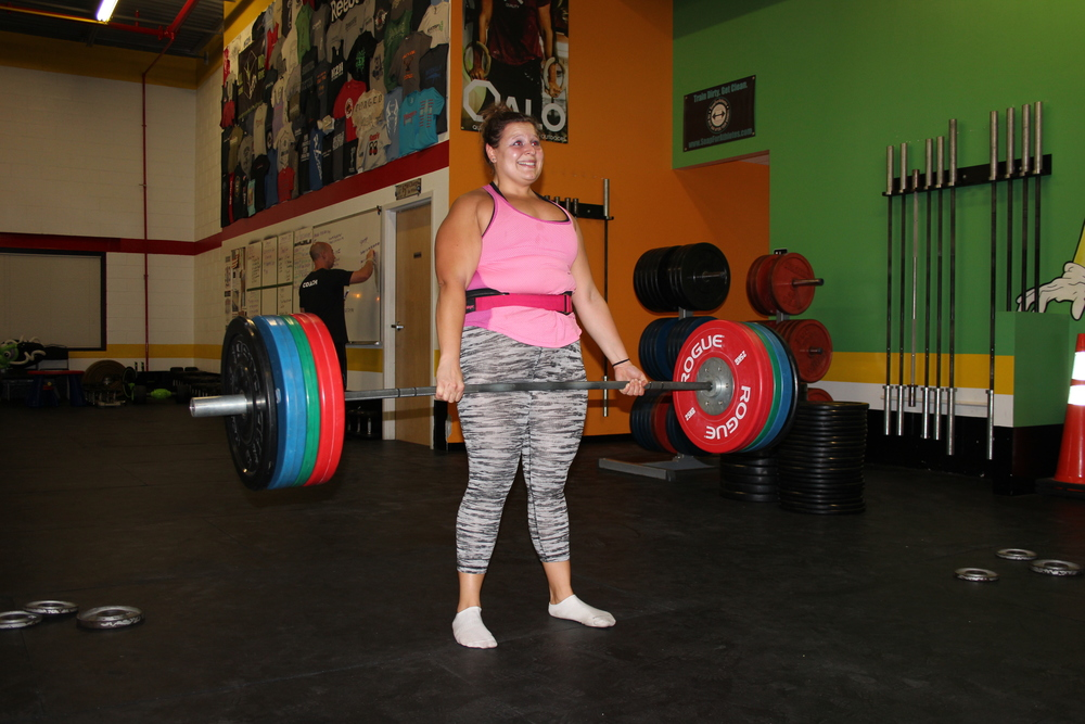 Throwback 10/29/15. Coach Kara. Those pretty red, green and blue plates are kilos.