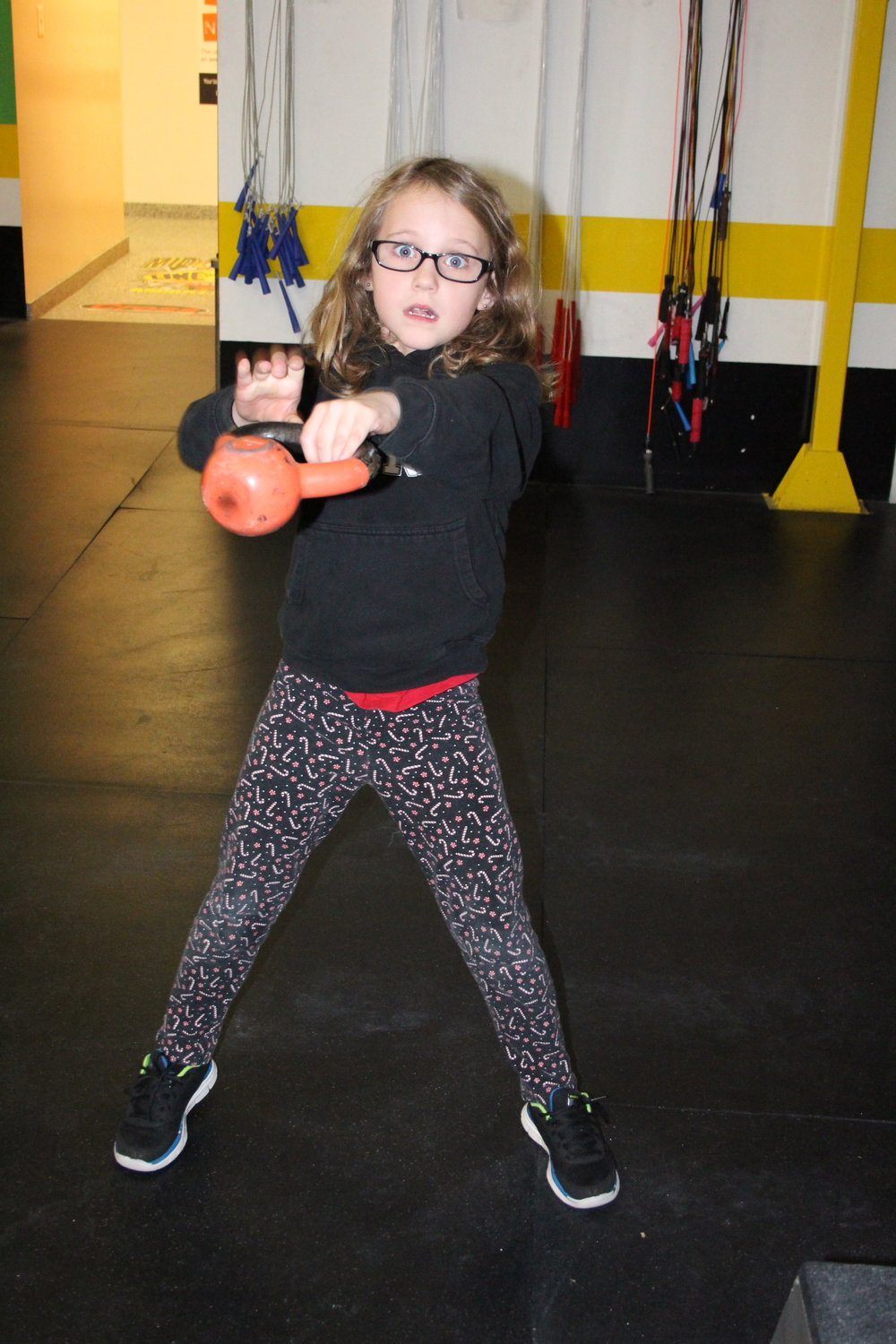 Sloane working on her Hand to hand Kettlebell Swing.