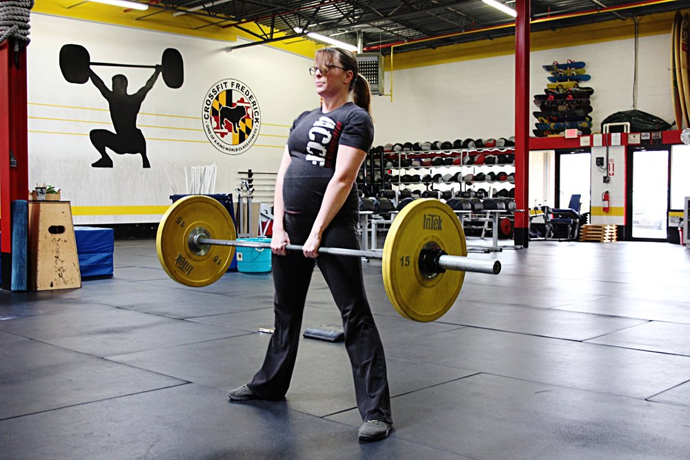 Tara @ 21 weeks pregnant maintaining her strength and conditioning. Way to go girl!
