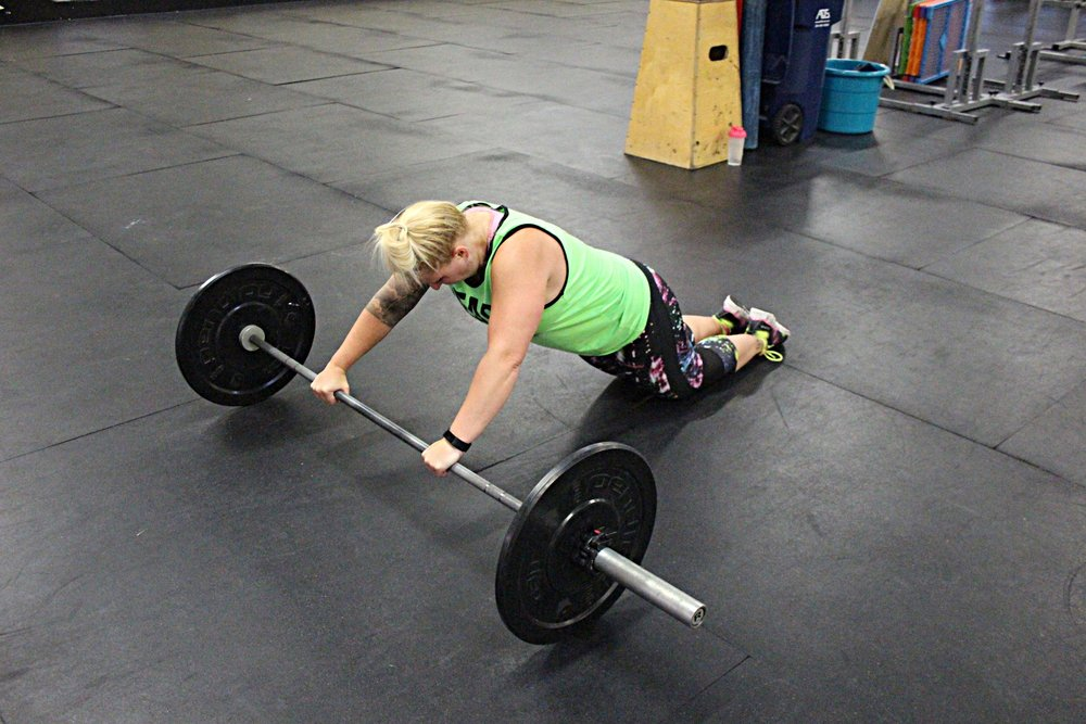 Barbell roll-outs. Model: Nicole :)