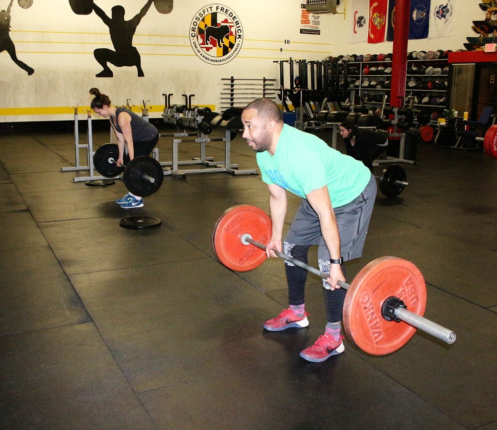 Underhand grip Deadlifts.