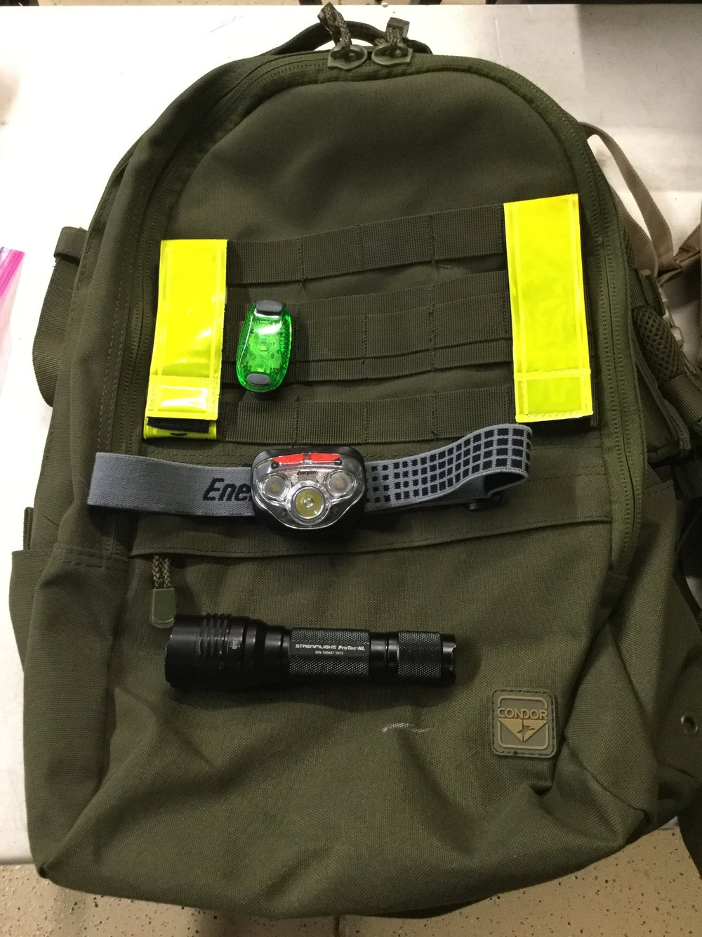 My ruck equipment optimized for night operations. Reflective bands, flashing strobe, headlamp, and tactical light.