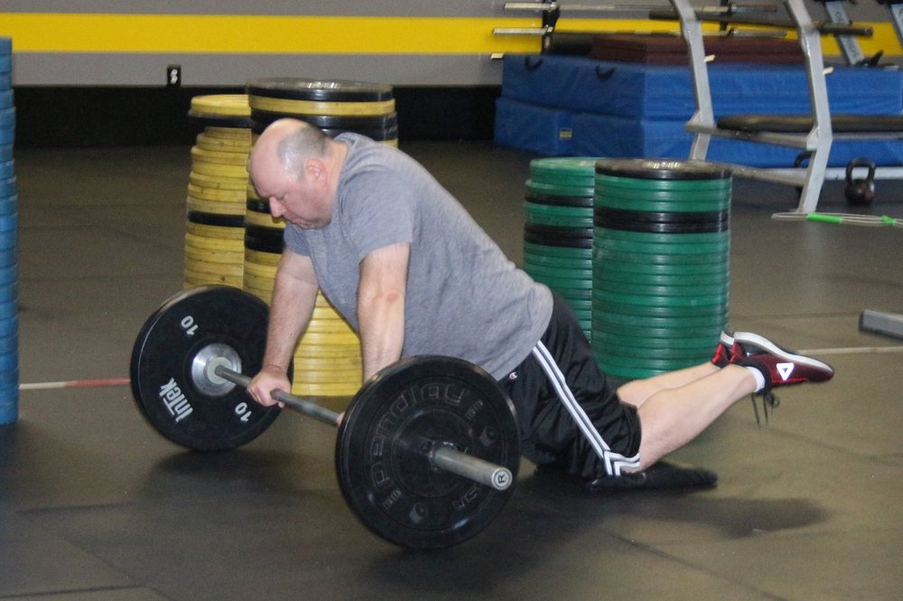 Phil doing barbell roll-outs.