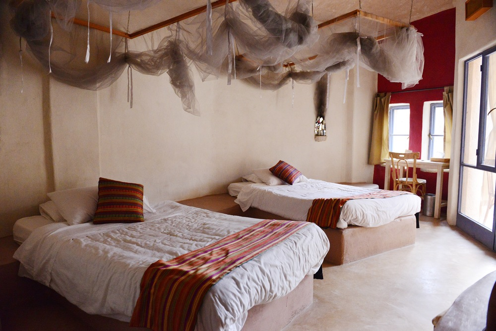 Double guestroom with balcony at Feynan Ecolodge.