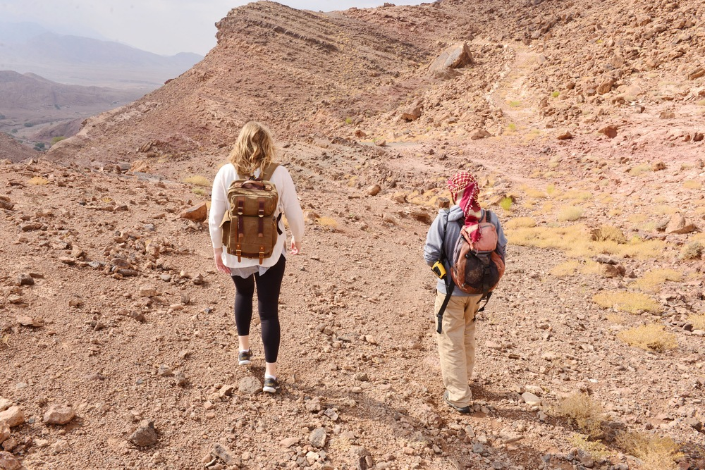 Charlotte & our Bedouin guide hiking along the ancient copper mine trail in the Dana Biosphere Nature Reserve.