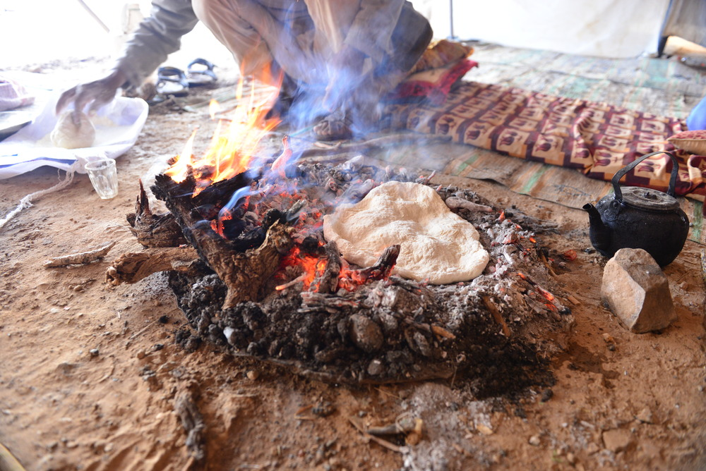 Bedouin making bread during a local community visit.