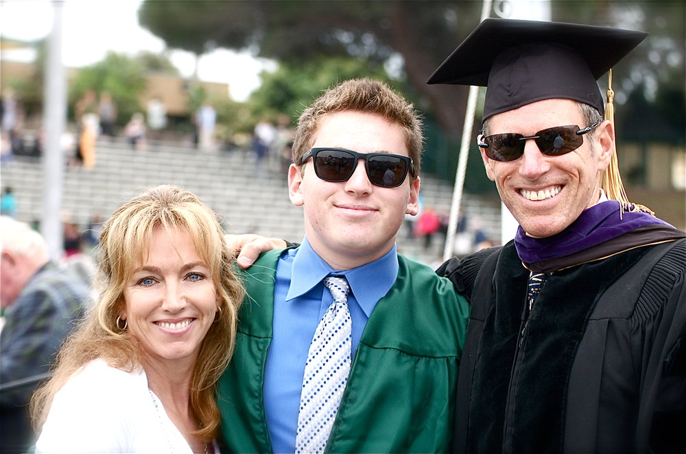 CJ grad with M&D.JPG