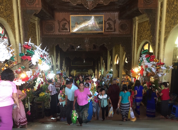One of the four stairwells (north, south, east and west). Flowers, tinsel decorations, trinkets, statues, incense, and other offerings line the stairs to people to buy.