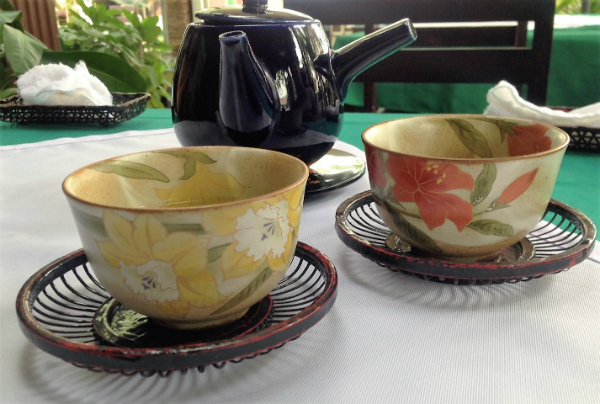 Cups of hot green tea