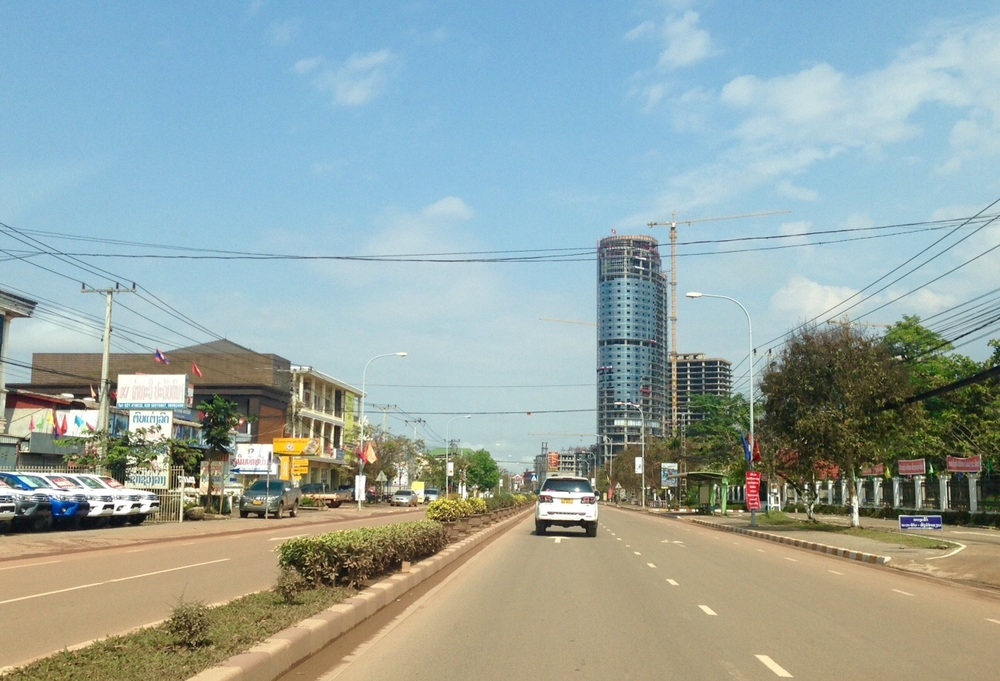 Route 13 north of the city towards the airport. The tall building in the background is a Chinese hotel under construction