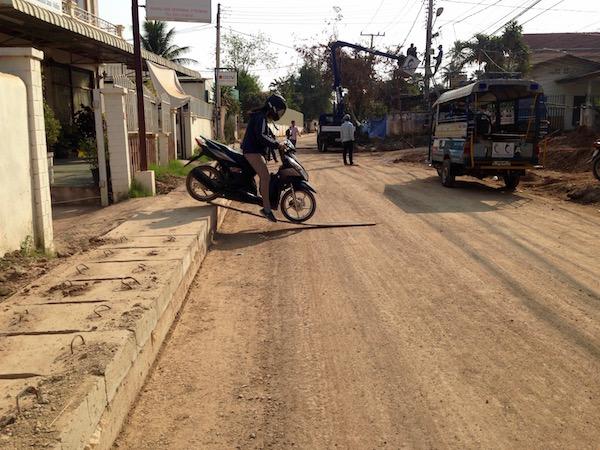eatdrinklaos-roadworks-vientiane-motorbike