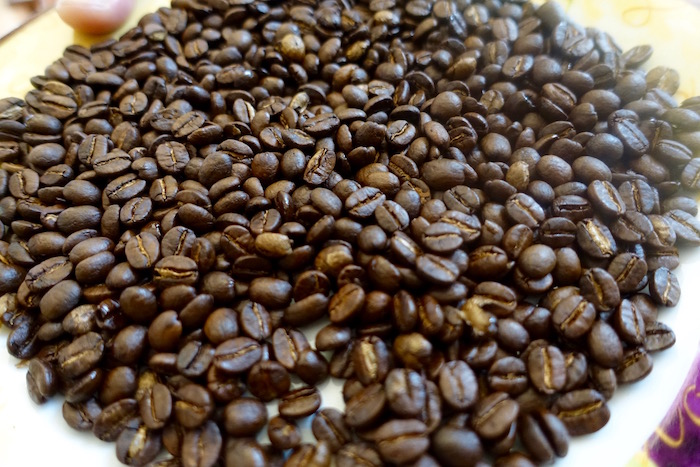 Medium roasted Caturra beans, straight out the roaster. Mmm, they smell good!