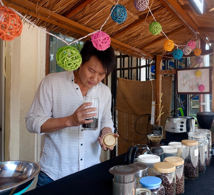 Owner and coffee lover Mr Lat at his downtown Vientiane cafe, Cubic Gallery