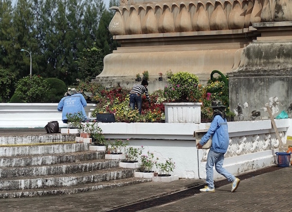 Gardeners plant new flowers around the steps of Patuxai, ASEAN Fever | Eat Drink Laos http://eatdrinklaos.com/blog/asean-fever