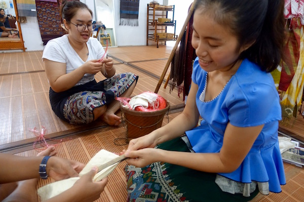 Create your pattern using pieces of wood tied across your scarf - traditional Lao silk scarf dyeing at Houey Hong in Vientiane, Laos, a vocational training centre for women weavers | Eat Drink Laos http://eatdrinklaos.com/blog/vientiane-houey-hong