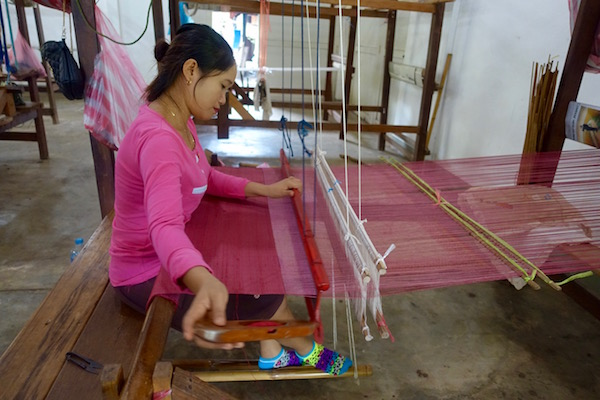 Lao women weavers works traditional wooden looms to create beautiful 100% Lao silk textiles - An authentic Lao traditional weaving experience at Houey Hong in Vientiane, Laos, a vocational training centre for women weavers | Eat Drink Laos http://eatdrinklaos.com/blog/vientiane-houey-hong