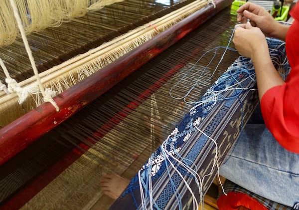 Lao women weavers work traditional wooden looms to create beautiful 100% silk textiles - An authentic Lao traditional weaving experience at Houey Hong in Vientiane, Laos, a vocational training centre for women weavers | Eat Drink Laos http://eatdrinklaos.com/blog/vientiane-houey-hong