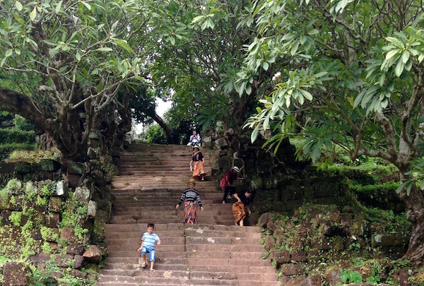 A mere 70 steps, almost vertical steps lead up to the sacred shrine and the main part of the complex of the 1,000 year old Wat Phu, a Khmer Hindu temple ruin, in Champasak, Laos | Eat Drink Laos http://eatdrinklaos.com/blog/southern-laos-wat-phu