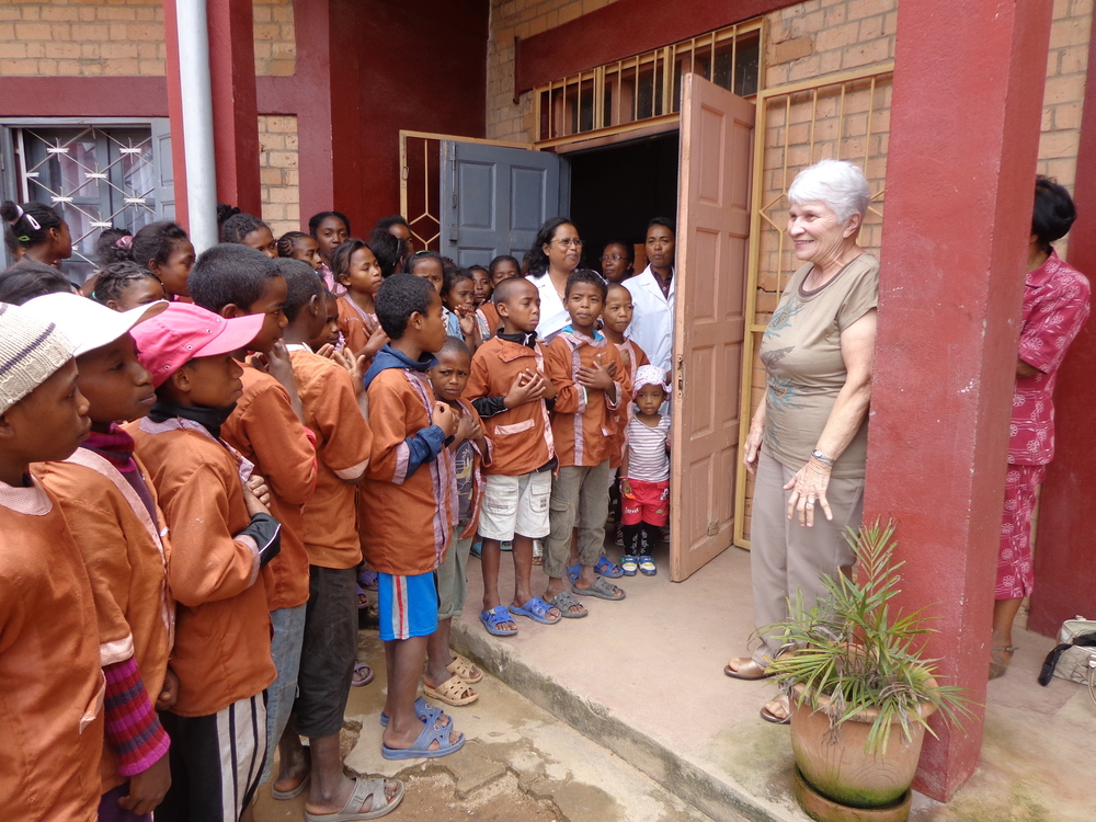 "AKANY TAFITA is an ""inner city centre for children and youth"".   86 children come daily to this  elementary schoo l. When founder and missionary  Mary Sherwood  went to visit during her recent trip to Madagascar, the children welcomed her with singing and little welcome speeches!! Mary is from Carleton Place."