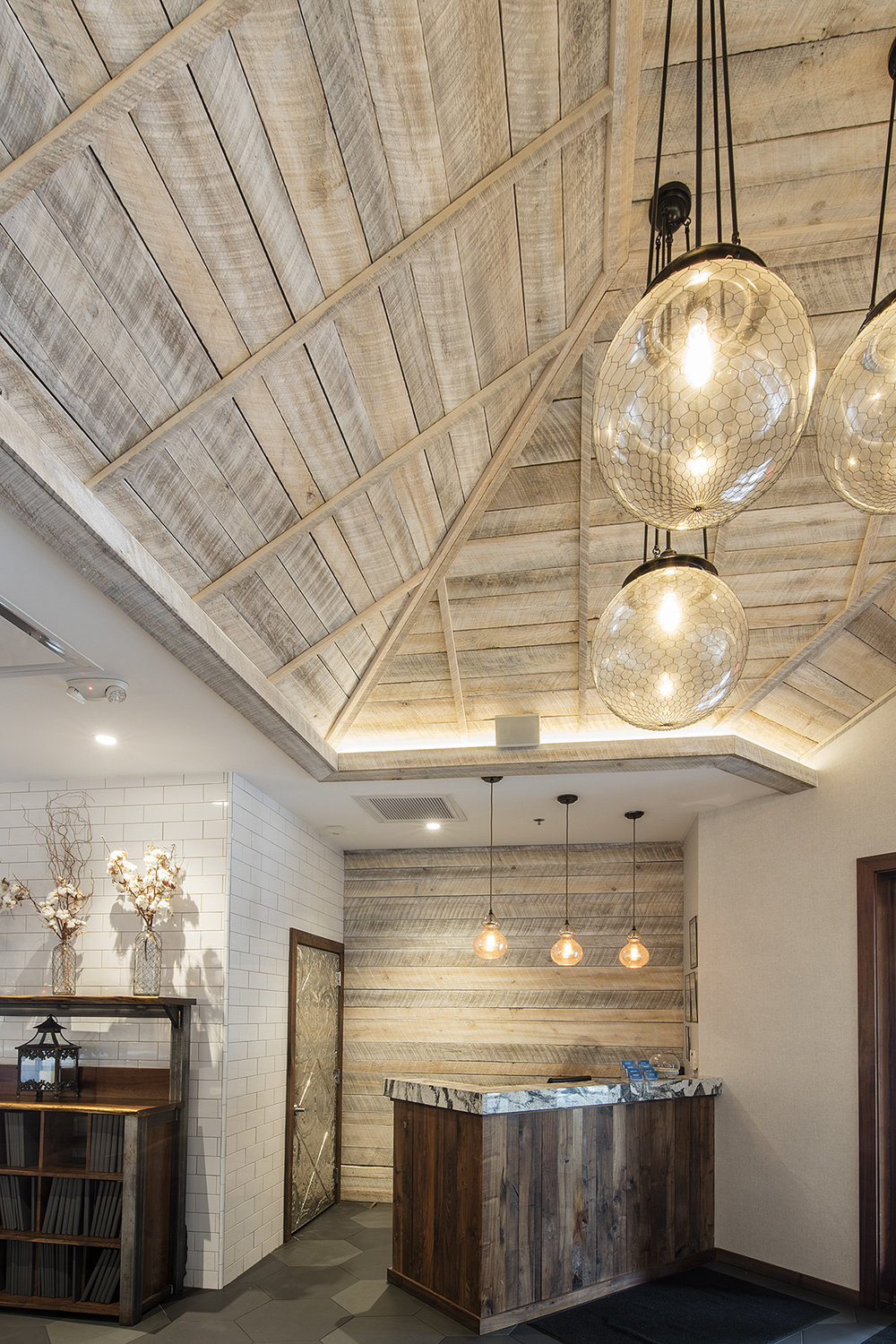Photo: Alston Thompson Photography  Wall and ceiling panelling, and desk at the Boathouse, Short Pump, Virginia, by Surface Architectural Supply.