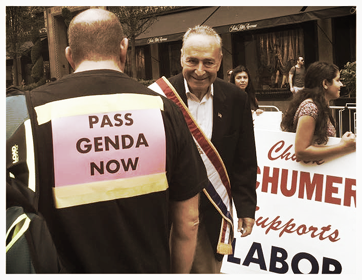 Pride at Work NYC/LI officer Jeff Oshins greet Sen. Chuck Schumer and presses him on GENDA legislation.