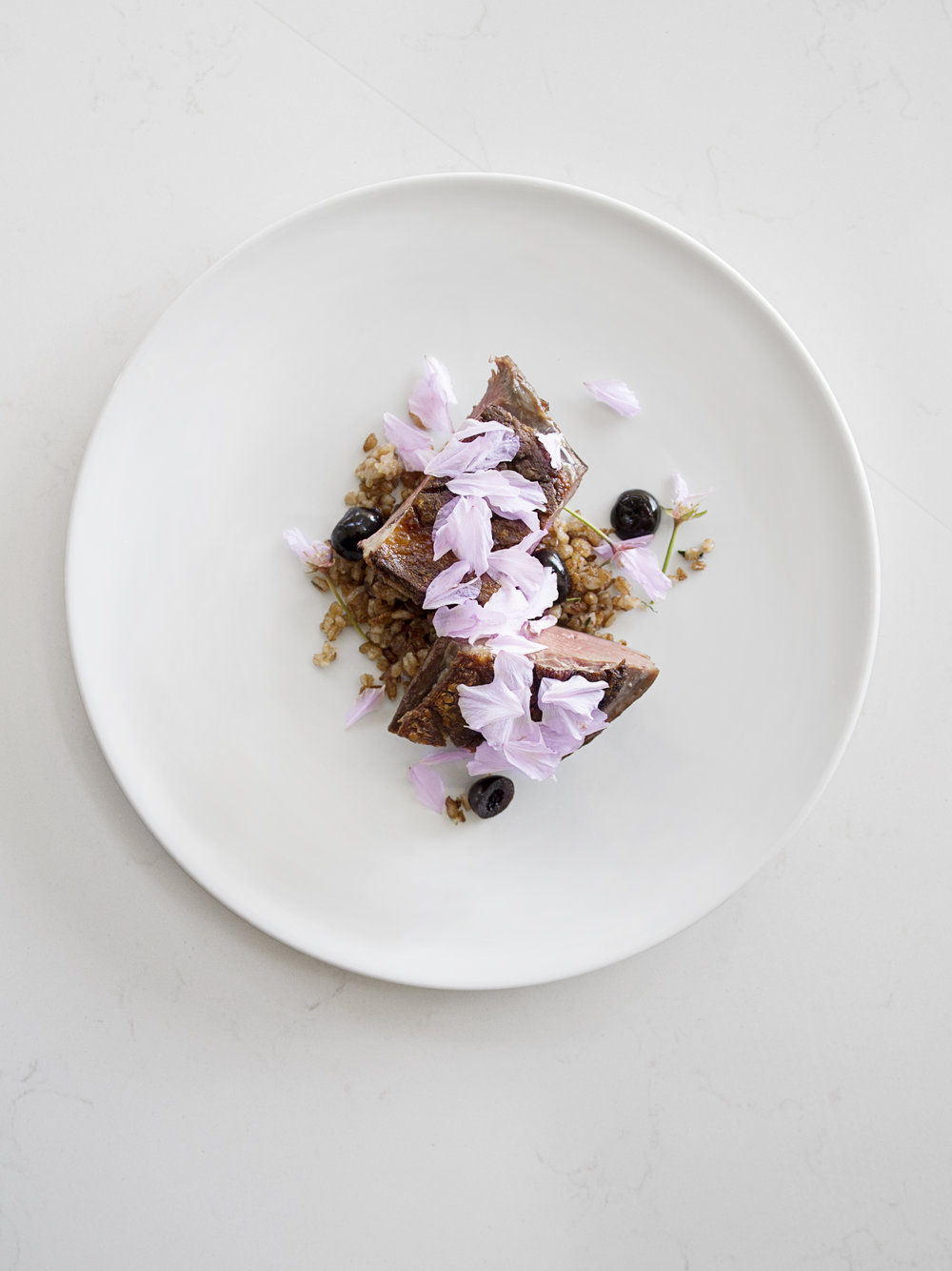 Magret Duck with foraged cherry blossoms and cracked wheat.